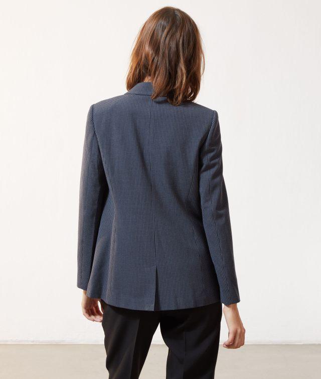 Veste de tailleur à carreaux noir.