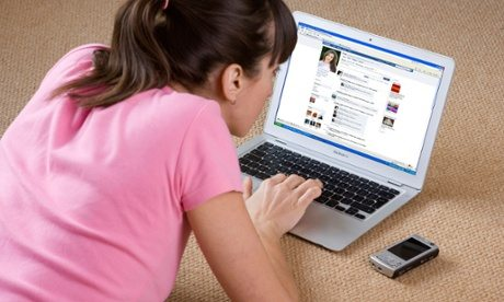 young woman looking at Facebook website on laptop computer. Image shot 2008. Exact date unknown.