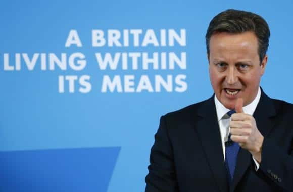 Britain's Prime Minister David Cameron gestures as he delivers a speech on the economy, in Nottingham