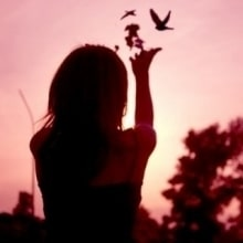 lady releasing birds from her hands