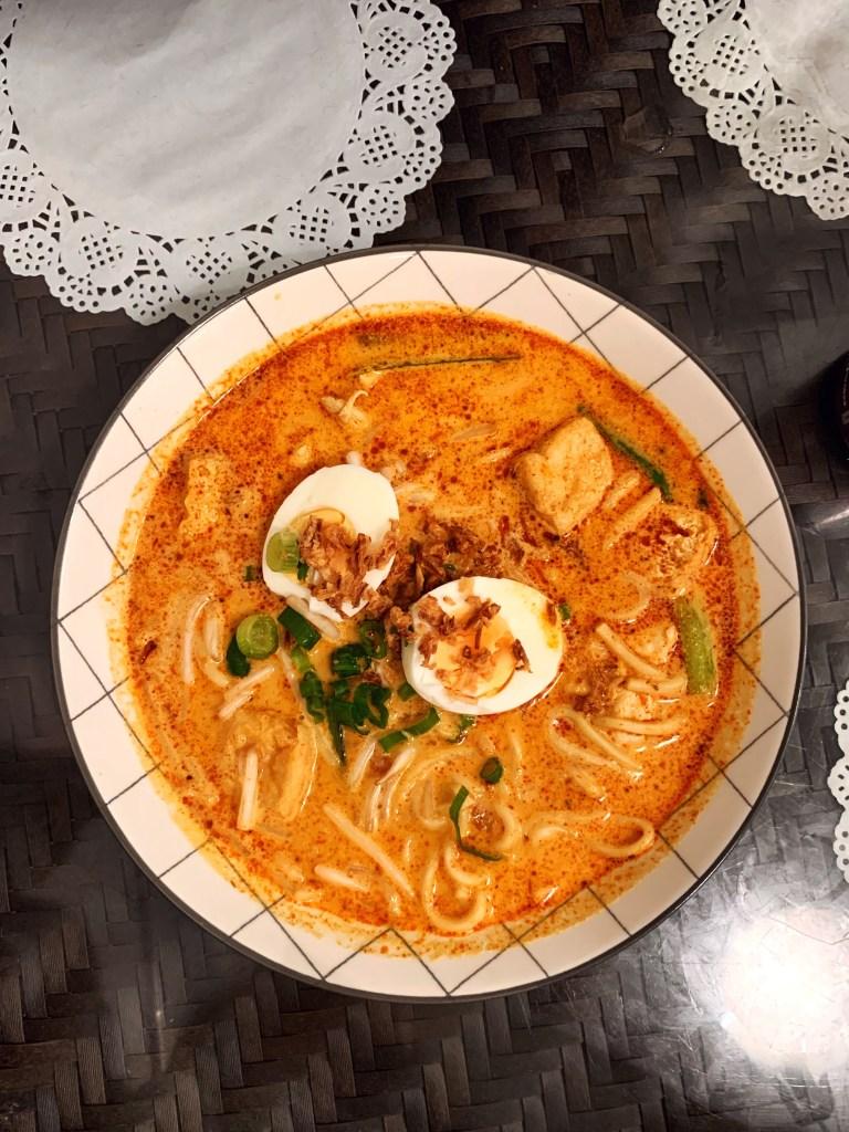 A bowl of Laksa noodle soup at Normah's