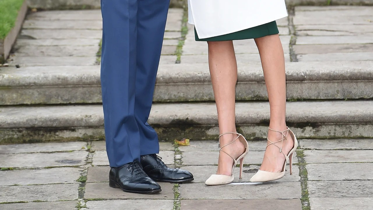 All The Details On Meghan Markles Stunning Engagement Photocall Outfit Entertainment Tonight