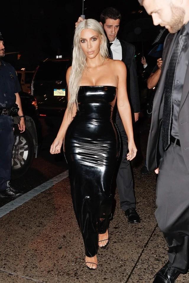 Kim Kardashian Rocks Long Platinum Hair And Black Latex At