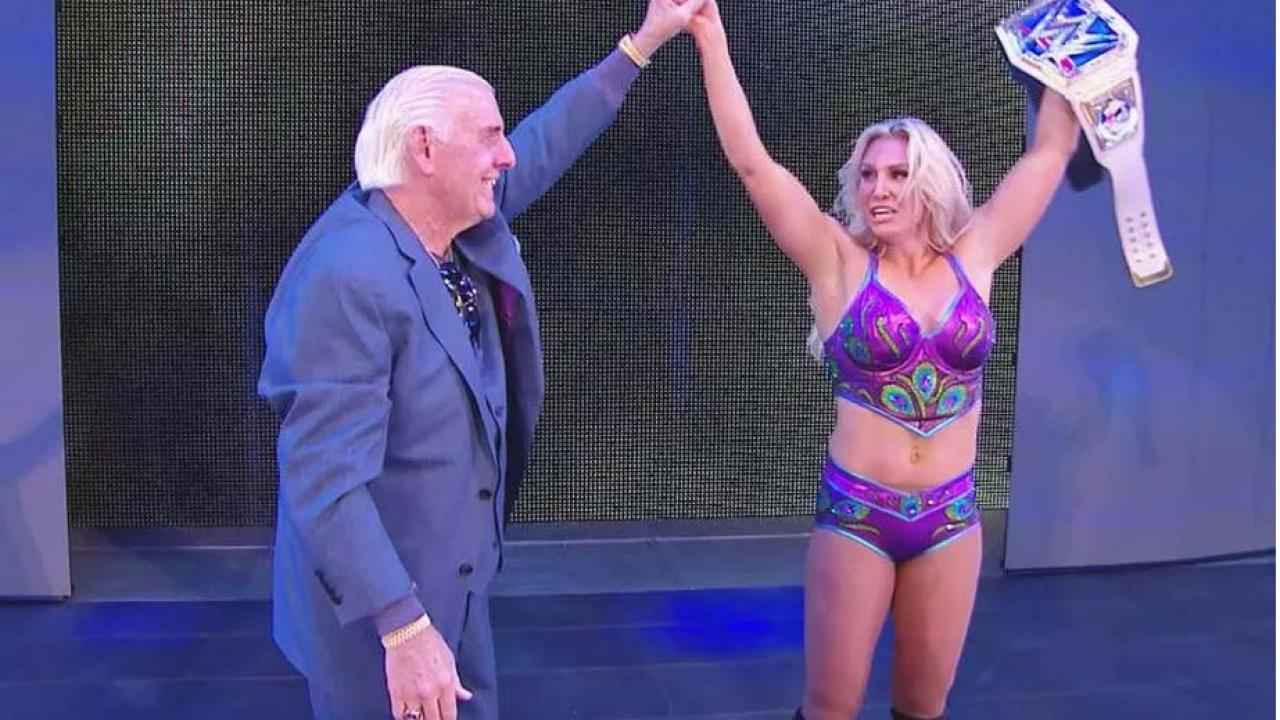 Image result for Charlotte Flair wins SmackDown Women's Championship, Ric Flair congratulates her