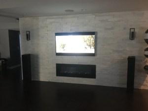 TV mounted on brick wall- Etronics of Illinois