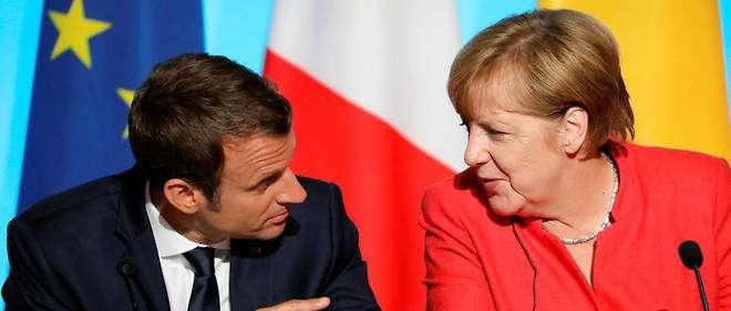 Angela Merkel et Emmanuel Macron à la COP 23 à Bonn . Un vrai couple sur la scène? Une volonté commune affirmée , mais sans engagements forts.
