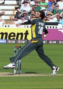 Afridi bowling his stock leg-spin delivery