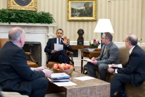 President Barack Obama receives a briefing on the earthquake in Japan and the tsunami warnings across the Pacific in the Oval Office, March 11, 2011. Briefing the President, from left, are: Assistant to the President for Homeland Security John Brennan; National Security Staff Senior Director for Resilience Richard Reed; and National Security Staff Director Asian Affairs Daniel Russel. (Official White House Photo by Pete Souza)