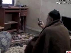 Osama Bin Ladin watches himself on TV