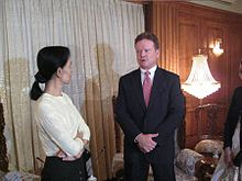 U.S. Senator Jim Webb visiting Suu Kyi in 2009. Webb negotiated the release of John Yettaw, the man who trespassed in Suu Kyi's home, resulting in her arrest and conviction with three years' hard labor.