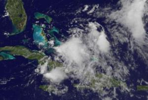 Caption: This visible image of Emily's remnant clouds was taken from the GOES-13 satellite on Aug. 5 at 16:01 UTC (12:01 p.m. EDT) just north of the eastern tip of Cuba. Higher thunderstorms in the center are casting small shadows on the lower, less powerful thunderstorms around them.  Credit: NASA/NOAA GOES Project, Dennis Chesters