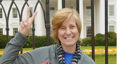 Cindy Sheehan in front of White House. Photo by Ben Schumin, Wikipedia Commons.