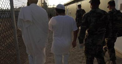 Guantanamo detainees being shown to their new living quarters. Photo by Chief Petty Officer John F. Williams, U.S. Navy.