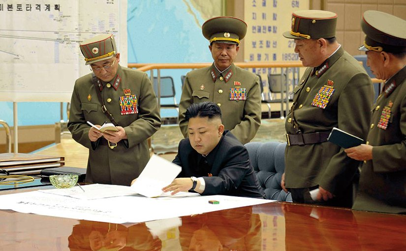 KimKim Jong-un sitting at desk in what appears a dedicated military operations room