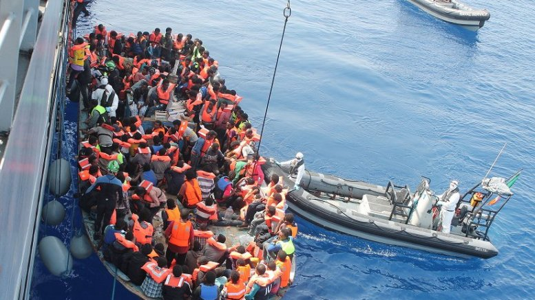 Irish Naval personnel from the LÉ Eithne (P31) rescuing migrants as part of Operation Triton. Photo Credit: Irish Defence Forces, Wikipedia Commons.