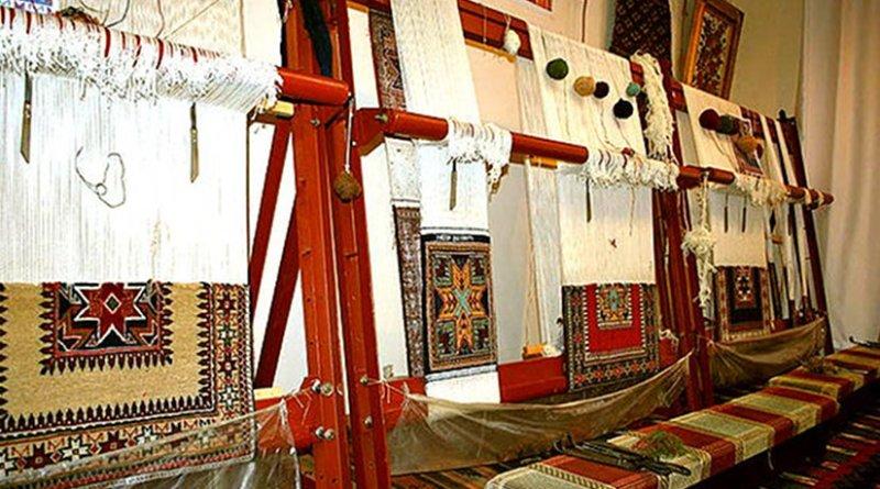 "Carpets on the looms. Carpet museum by ""Khazar"" University of Baku, Azerbaijan. Photo by Buyerlerdeqalardim, Wikipedia Commons."
