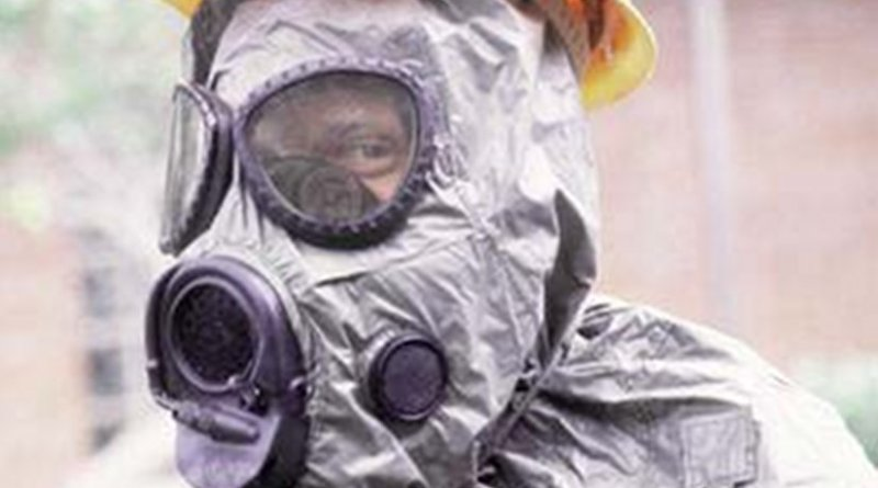 United States Airman wearing an M-17 nuclear, biological, and chemical warfare mask and hood. Photo by Senior Airman Walker, Kadena Air Force Base. - U.S. Department of Defense (DOD)