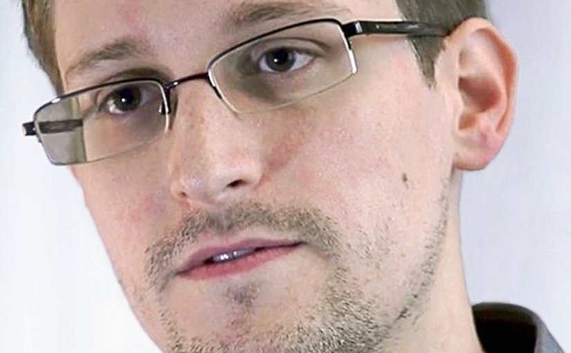 Edward Snowden. Photo Credit: Screenshot of the film Prism by Praxis Films, Laura Poitras, Wikipedia Commons.