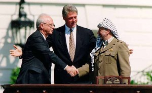 Yitzhak Rabin, Bill Clinton, and Yasser Arafat at the Oslo Accords signing ceremony on September 13, 1993. Photo Credit: Vince Musi, The White House.