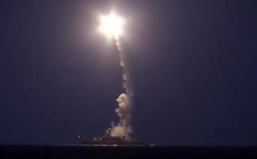 A screenshot from a video released by Russia's defense ministry shows a Russian warship firing cruise missiles into Syria from the Caspian Sea.