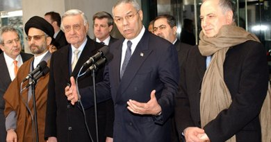 U.S. Secretary of State Colin Powell with Members of The Iraqi Governing Council After Their Meeting. Pictured from left to right: Abdul Aziz Al Hakim; Dr. Adnan Pachachi, President of Iraqi Governing Council for January 2004; Ambassador Paul Bremer, U.S. Presidential Envoy to Iraq; Secretary Powell and Dr. Ahmed Chalabi. U.S. State Department photo by Michael Gross.