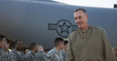 U.S. Marine Corps Gen. Joseph F. Dunford Jr., chairman of the Joint Chiefs of Staff, meets on the flightline of Yokota Air Base, Japan, with U.S. airmen assigned the 374th Airlift Wing, Nov. 4, 2015. DoD photo by U.S. Navy Petty Officer 2nd Class Dominique A. Pineiro