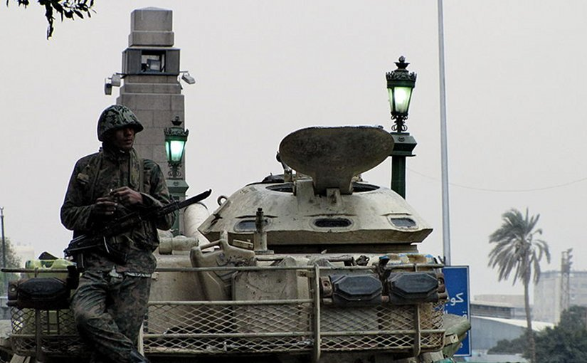 An Egyptian soldier and tank in Tahrir Square, during the 2011 Egyptian Revolution.