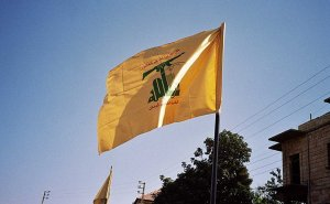 Hezbollah flag waving in Syria. Photo by Upyernoz, Wikipedia Commons.