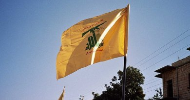 Hezbolah flag waving in Syria. Photo by Upyernoz, Wikipedia Commons.