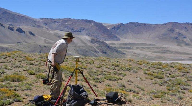 Basil Tikoff, professor of geoscience at UW-Madison, uses a precise GPS instrument to record shoreline altitude at Laguna del Maule. Credit Brad Singer, University of Wisconsin-Madison