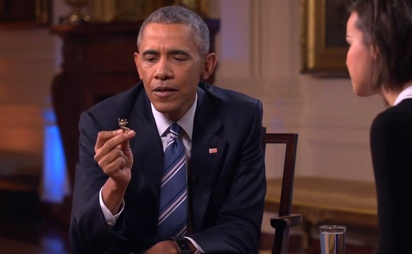 US President Barack Obama shows Ingrid Nilsen the Hindu Lord Hanuman figurine he carries in his pocket. Source:Screenshot White House video.