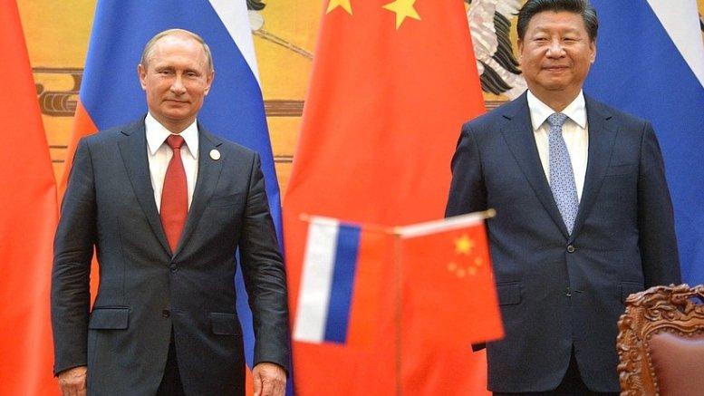 Russia's President Vladimir Putin meets with President of China Xi Jinping. Photo Credit: Kremlin.ru