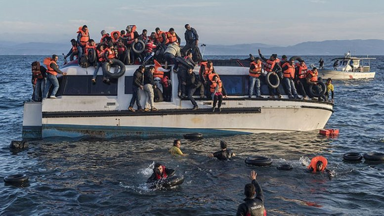 Syrian and Iraqi immigrants getting off a boat from Turkey on the island of Lesbos, Greece. Photo by Ggia, Wikipedia Commons.