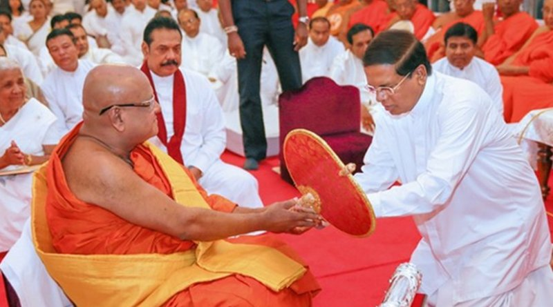 Sri Lanka's President Maithripala Sirisena participates in ceremony to offer Sannas Pathraya to new Anu Nayaka Thero. Photo Credit: Sri Lanka government.