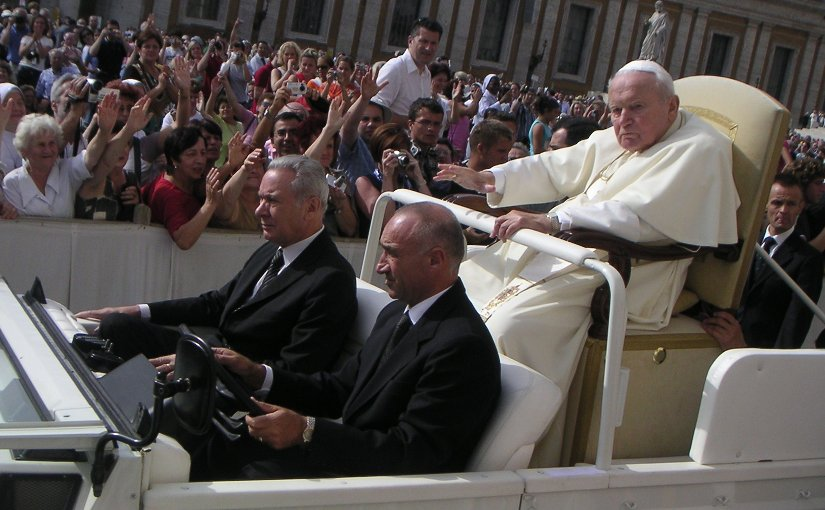 An ailing John Paul II riding in the Popemobile. Source: Wikipedia Commons.
