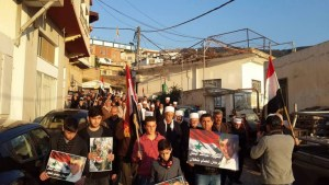 Procession in Ein Qiniyya following the Israeli airstrike in Jaramana: note the focus is primarily on commemorating Farhan Sha'alan rather than Quntar. Photo via Syria Comment.
