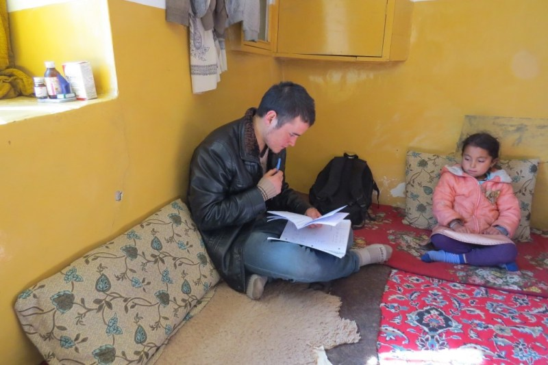 Zek conducting the survey in Zuhair's home. Zuhair's sister is looking on. Photo by Dr. Hakim.