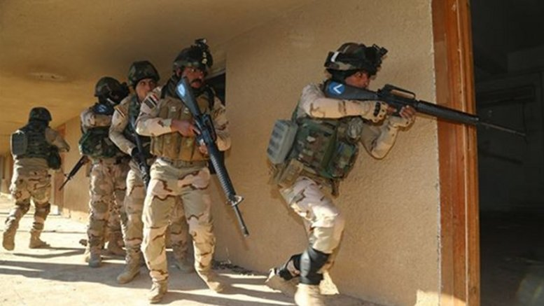 Iraqi soldiers from 2nd Battalion, 71st Brigade, enter a room after breaching the doorway to ensure that it is clear at Camp Taji, Iraq, Jan. 10, 2016. Task Group Taji provides company-level urban operations training to teach Iraqis how to move and communicate in an urban environment. Training at the building partner capacity sites is an integral part of Combined Joint Task Force – Operation Inherent Resolve's multinational effort to train Iraqi security force personnel to defeat the Islamic State of Iraq and the Levant. Army photo by Sgt. Kalie Jones