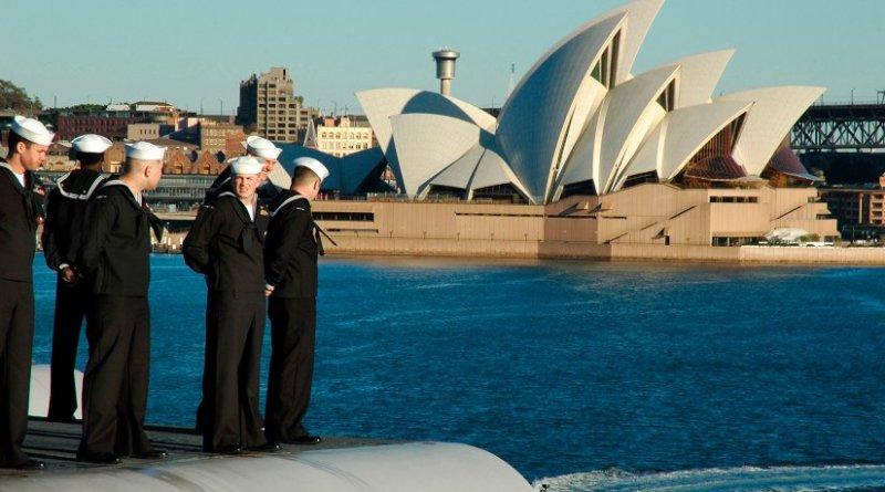 U.S. sailors man the rails aboard USS Kitty Hawk (CV-63) sails the Sydney Opera House while pulling into Sydney, Australia in 2005. US Navy Photo
