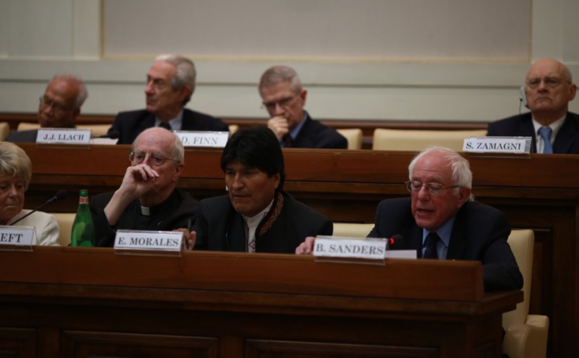 """Ecuador's Evo Morales and US' Bernie Sanders at at a conference celebrating the 25th anniversary of Pope John Paul II's """"Centesimus Annus."""" Photo Credit: Bernie Sanders for 2016 Website."""