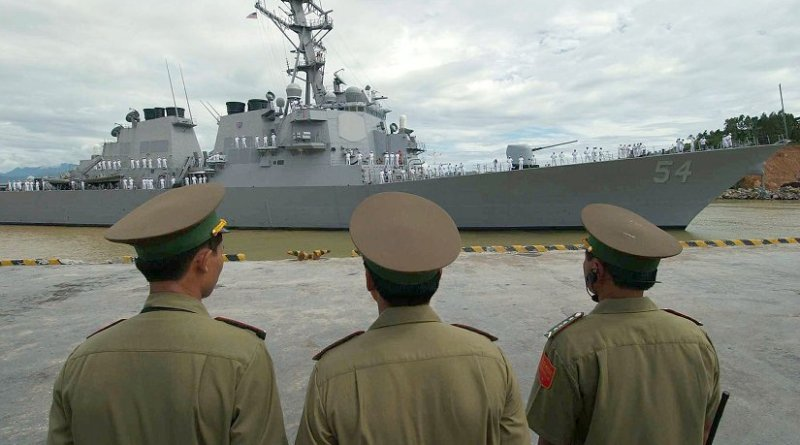 Vietnamese military officials watch as USS Curtis Wilbur (DDG 54) prepares to moor in the Vietnamese port of Da Nang. U.S. Navy photo by Photographer's Mate 2nd Timothy Smith
