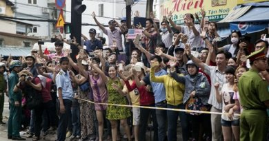 People wave from along the street as President Barack Obama passed by in a motorcade after arriving in Ho Chi Minh City, Vietnam, May 24, 2016. (Official White House Photo by Pete Souza)