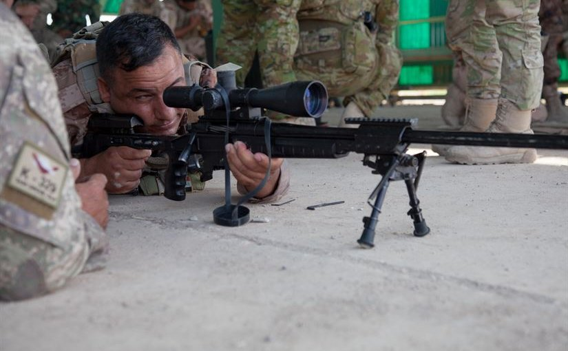 A New Zealand soldier, left, advises an Iraqi soldier adjusting his rifle's sights at Camp Taji, Iraq, June 7, 2016. Increased training for Iraqi police officers will add to the existing 23,000 trained Iraqi forces, and training will soon expand to the Iraq border security force, British army Maj. Gen. Doug Chalmers, Combined Joint Task Force-Operation Inherent Resolve deputy commander for strategy and sustainment, told the Pentagon press corps, today. Army photo by Spc. Jessica Hurst