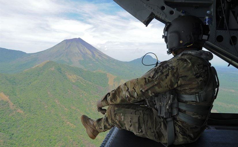 Army Sgt. King David, a CH-47 Chinook crew chief with the 1st Battalion, 228th Aviation Regiment, observes the San Cristobal volcano, one of at least six active volcanoes in Nicaragua, while transporting the Joint Task Force-Bravo U.S. Southern Command Situational Assessment Team, May 19, 2016. The JTF-Bravo S-SAT was invited to Nicaragua to demonstrate their ability to respond to a disaster situation. Air Force photo by Capt. David Liapis