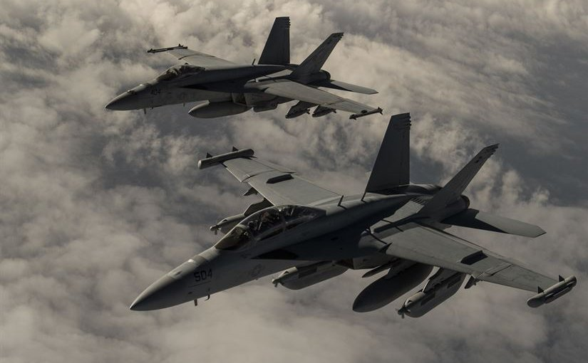 U.S. Navy F-18 Hornet fighters fly over Iraq. Air Force photo by Staff Sgt. Corey Hook.