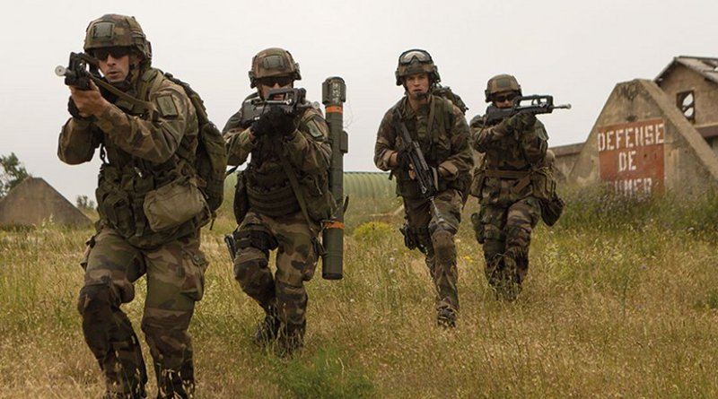 French soldiers with French Foreign Legion's 6th Light Armored Brigade assault objective during bilateral seize-and-capture training exercise with U.S. Marines on Quartier Colonel de Chabrieres, France, May 29, 2015 (U.S. Marine Corps/Christopher Mendoza)
