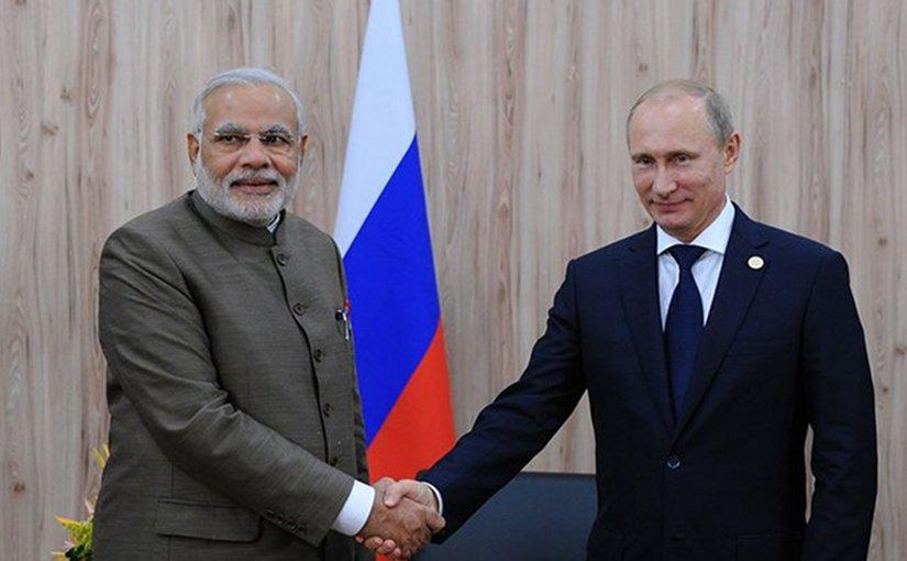 Russia's Vladimir Putin shakes hand with India's Narendra Modi. Photo Credit: Kremlin.ru, Wikipedia Commons.