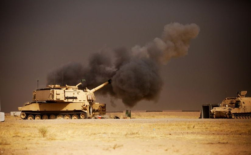 A U.S. Army M109A6 Paladin howitzer conducts a fire mission at Qayyarah West Airfield, Iraq, in support of the Iraqi forces' push toward Mosul, Oct. 17, 2016. The support provided by the Paladin teams denies safe havens to the Islamic State of Iraq and the Levant while providing Iraqi forces with vital artillery capabilities during their advance. Army photo by Spc. Christopher Brecht