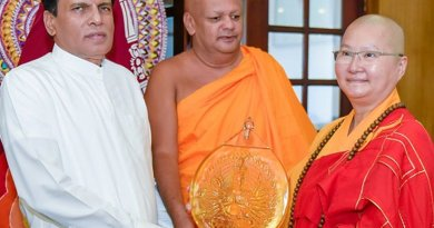 The President of the World Young Buddhist Sangha Sabha Ven. Shi Kuan female Buddhist Thero meets Sri Lanka's President Maithripala Sirisena. Photo Credit: Sri Lanka government.