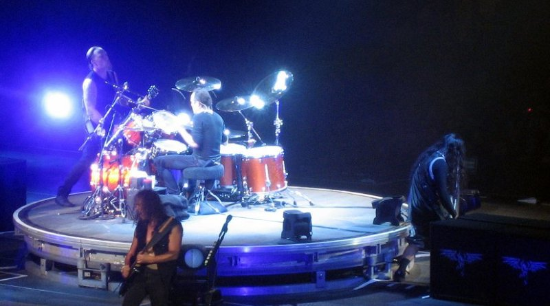 Members of Metallica performing onstage. Photo by Wonker, Wikipedia Commons.
